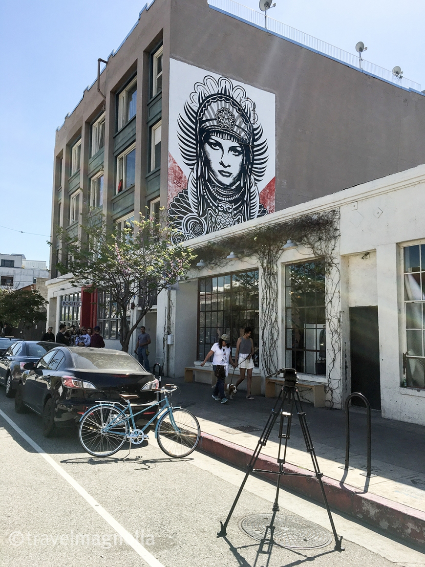 Shepard Fairey mural on building side in downtown LA