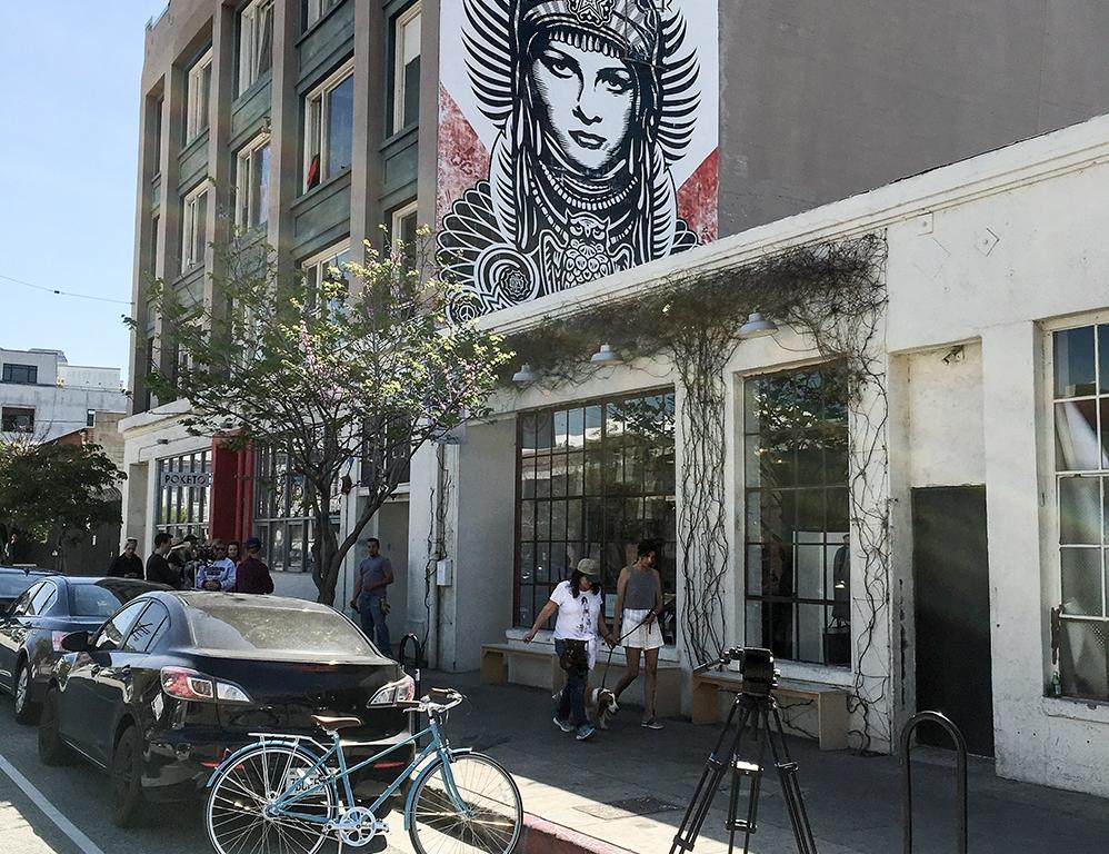 Shepard Fairey mural on building side in downtown LA