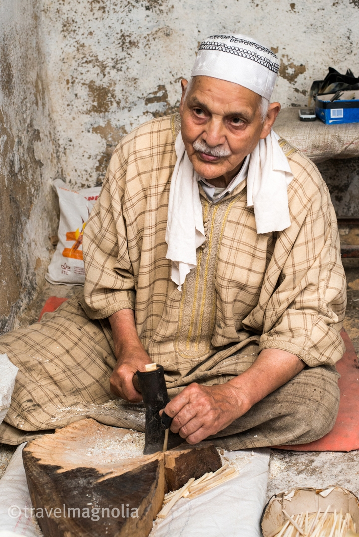In Fez's medina, an 86 year old Artisan works with camel bone to make combs and other small items.