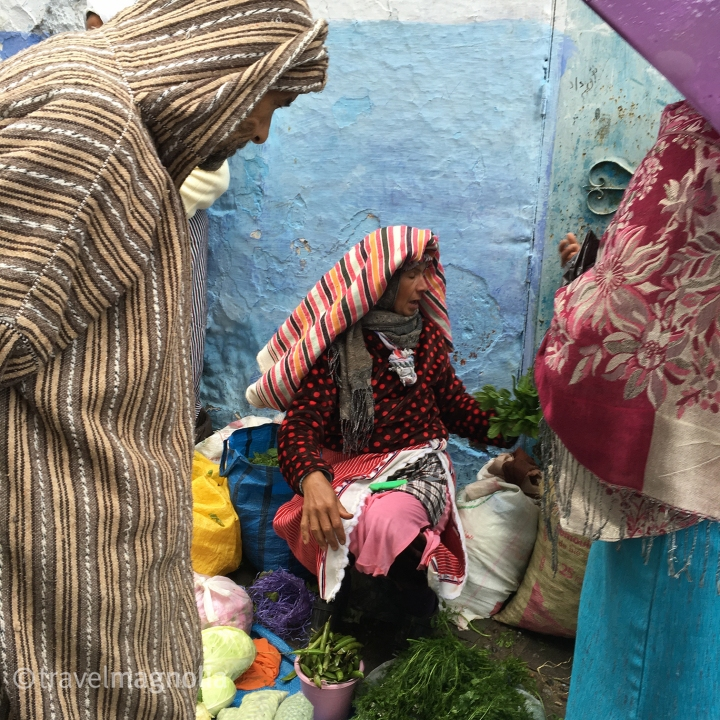 A Berber woman sells herbs in Chefchaouen on market day ©travelmagnolia2016
